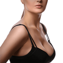 Woman from side view wearing black bra and enhanced breasts